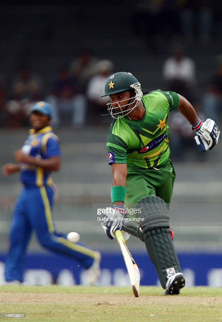 Pakistan's batsman Imran Farhat (L) just makes his ground after a quick single during the fifth one day international match between Sri Lanka and Pakistan at R. Premadasa Stadium on June 18, 2012 in Colombo, Sri Lanka.