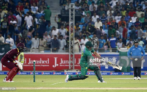 Pakistan's batsman Khalid Latif and West Indies' wicketkeeper Andre Fletcher watch the ball during the first T20I match between Pakistan and the West...
