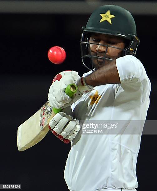 Pakistan's batsman Sarfraz Ahmed plays a shot during the fourth day of the daynight cricket Test match between Australia and Pakistan in Brisbane on...