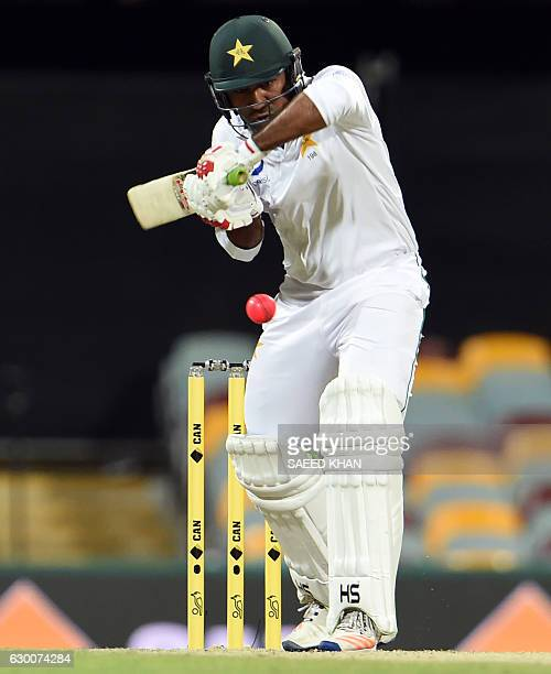 Pakistan's batsman Sarfraz Ahmed plays a shot during the second day of the daynight cricket Test match between Australia and Pakistan at the Gabba in...