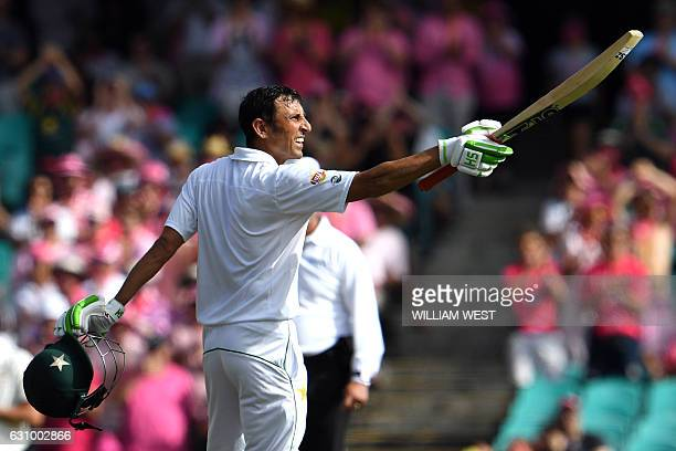 Pakistan's batsman Younis Khan celebrates after scoring a century against Australia during the third day of the third cricket Test match at the SCG...