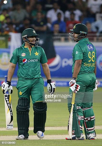 Pakistan's batsmen Khalid Latif and Sharjeel Khan talk during the second T20I match between Pakistan and the West Indies at the Dubai International...