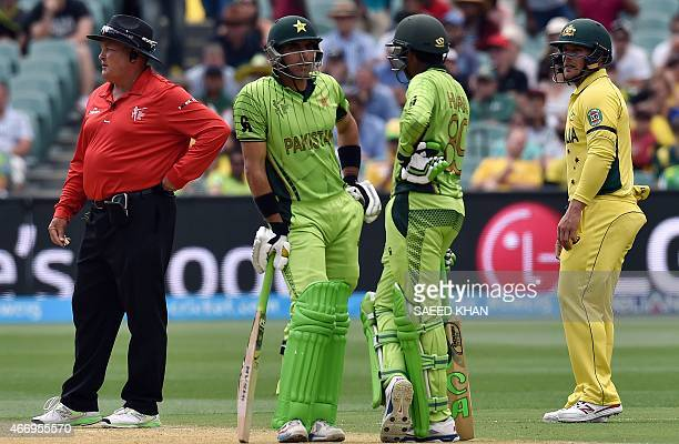 Pakistan's batting pair MisbahulHaq and Haris Sohail chat during the 2015 Cricket World Cup quarterfinal match between Pakistan and Australia at the...