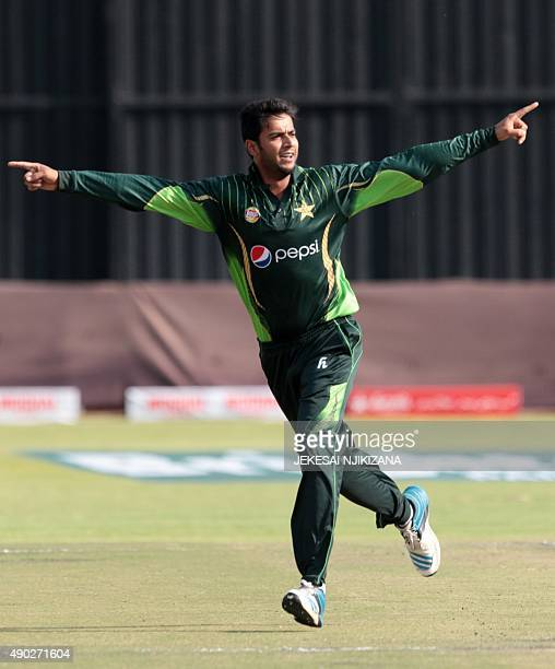 Pakistan's bowler Imad Wasim celebrates a wicket during the first of two T20 cricket matches between Pakistan and hosts Zimbabwe at the Harare Sports...