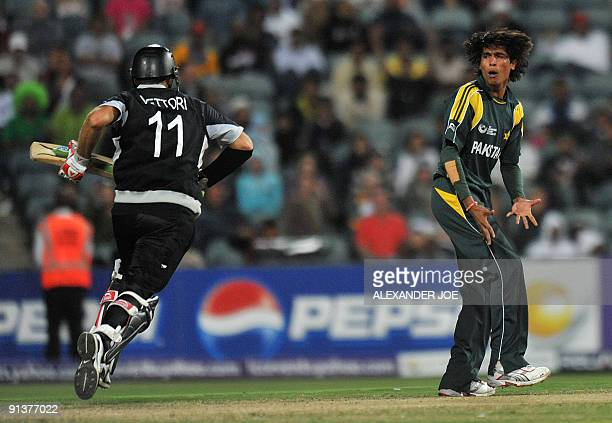 Pakistan's bowler Mohammad Aamir reacts to a bad ball on New Zealand's cricketer Daniel Vettori during ICC Champions Trophy 2nd semi final between...