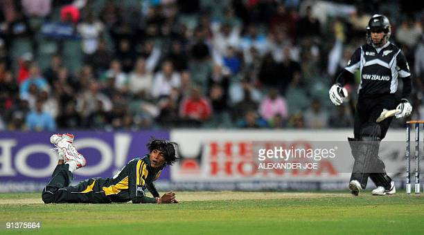 Pakistan's bowler Mohammad Aamir reacts to a ball of New Zealand's batsmen Ross Taylor during the ICC Champions Trophy 2nd semi final between...