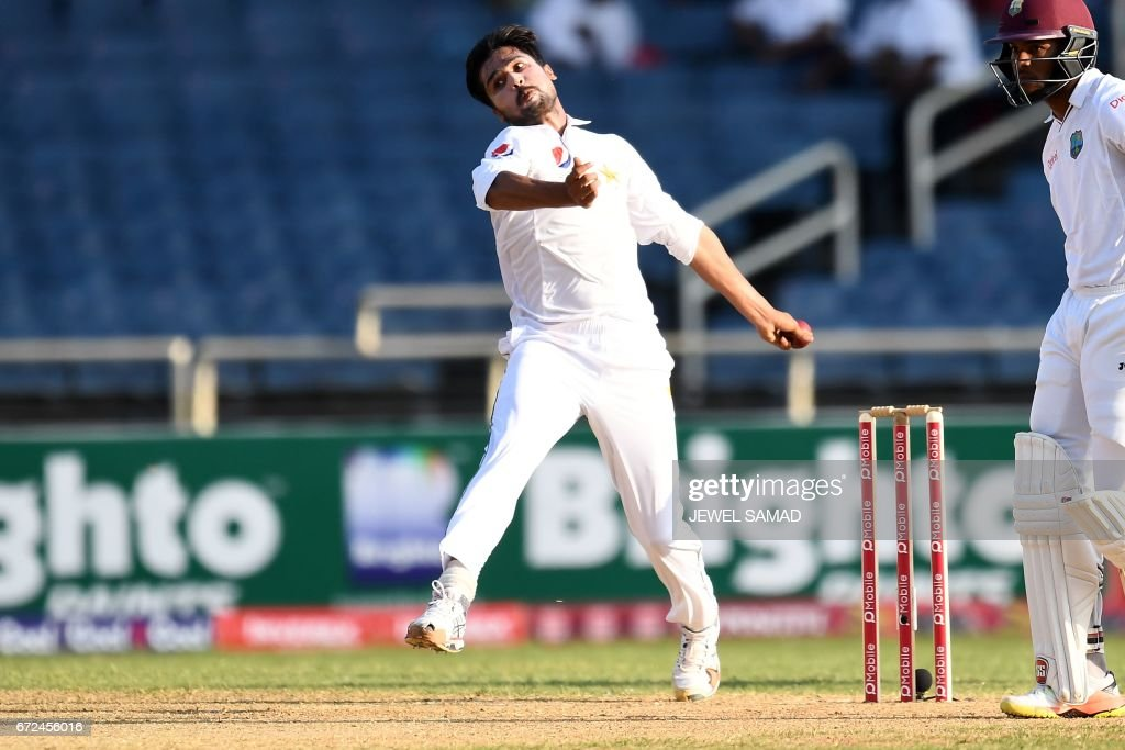 Pakistan's bowler Mohammad Amir delivers a ball on day four of the first Test match between West Indies and Pakistan at the Sabina Park in Kingston, Jamaica, on April 24, 2017. / AFP PHOTO / Jewel SAMAD