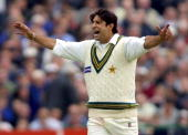 Pakistan`s bowler Wasim Akram celebrates the runout of England batsman Graham Thorpe during the 3rd day of the 2nd test match at Old Trafford in...