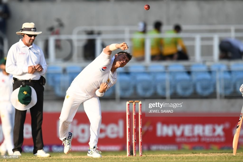 Pakistan's bowler Yasir Shah delivers a ball on day four of the first Test match between West Indies and Pakistan at the Sabina Park in Kingston, Jamaica, on April 24, 2017. / AFP PHOTO / Jewel SAMAD