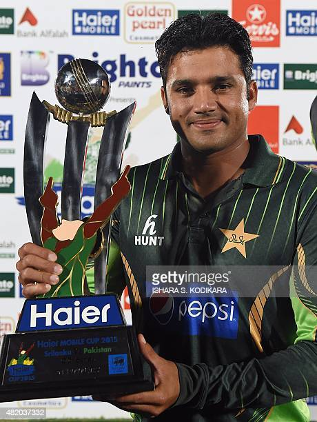 Pakistan's captain Azhar Ali poses with the trophy after his team's series victory following the fifth and final one day international cricket match...