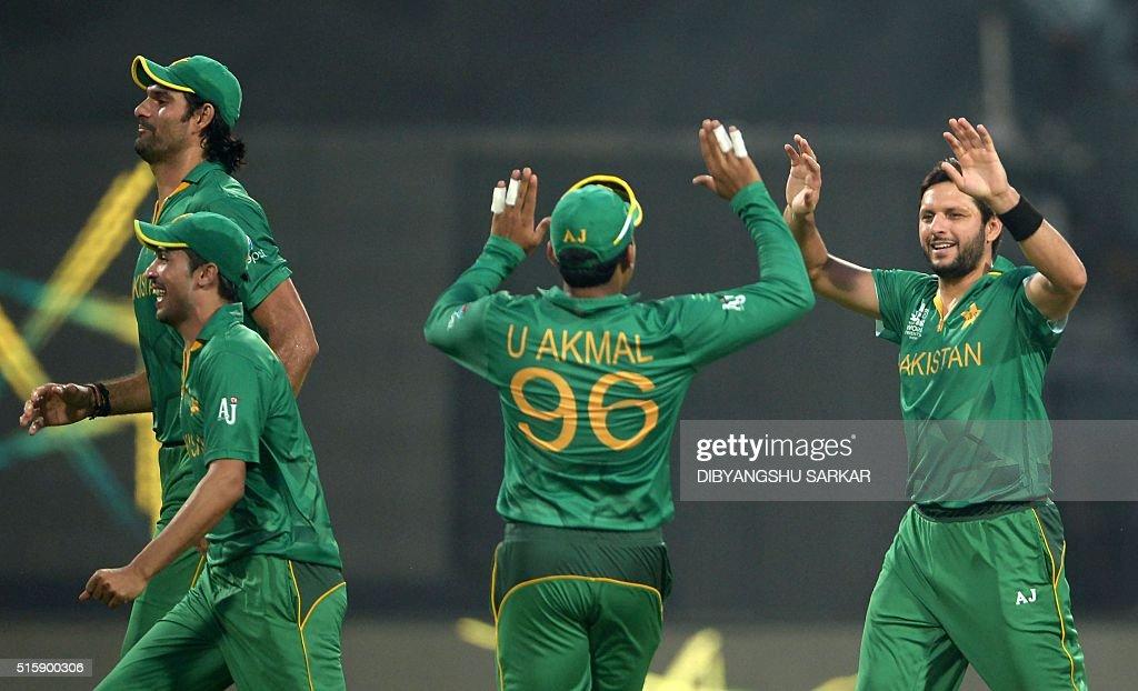 Pakistan's captain Shahid Afridi celebrates with teammates after the dismissal of Bangladesh's batsman Sabbir Rahman during the World T20 cricket...