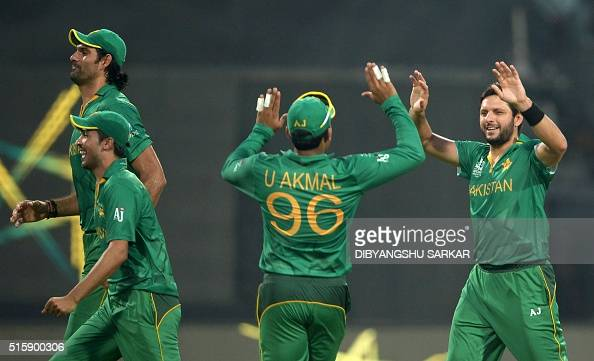 Pakistan's captain Shahid Afridi celebrates with teammates after the dismissal of Bangladesh's batsman Sabbir Rahman during the World T20 cricket...