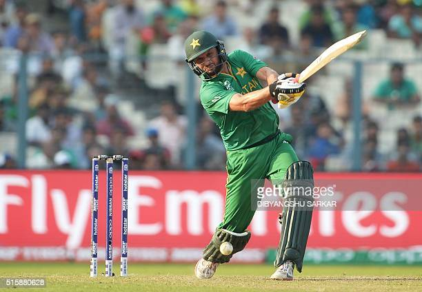 Pakistan's captain Shahid Afridi plays a shot during the World T20 cricket tournament match between Pakistan and Bangladesh at The Eden Gardens...