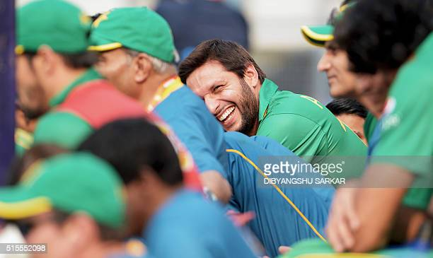 Pakistan's captain Shahid Afridi reacts as he watches a practice match between Pakistan and Sri Lanka at the Eden Gardens stadium during the World...
