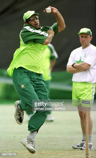 Pakistan's captain Wasim Akram is closely watched by coach Richard Pybus during the final net session before the World Cup Semi Final at Old Trafford...