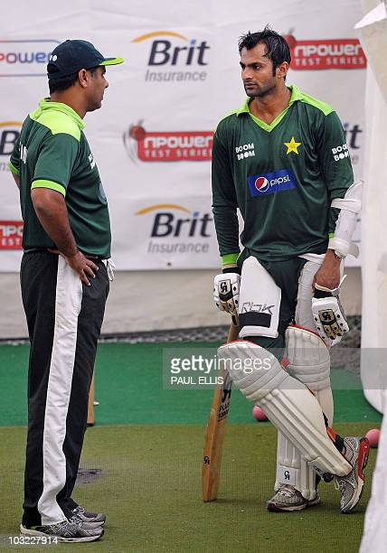 Pakistan's coach Waqar Younis talks with Shoaib Malik during a team training session in the indoor nets at Edgbaston in Birmingham central England on...