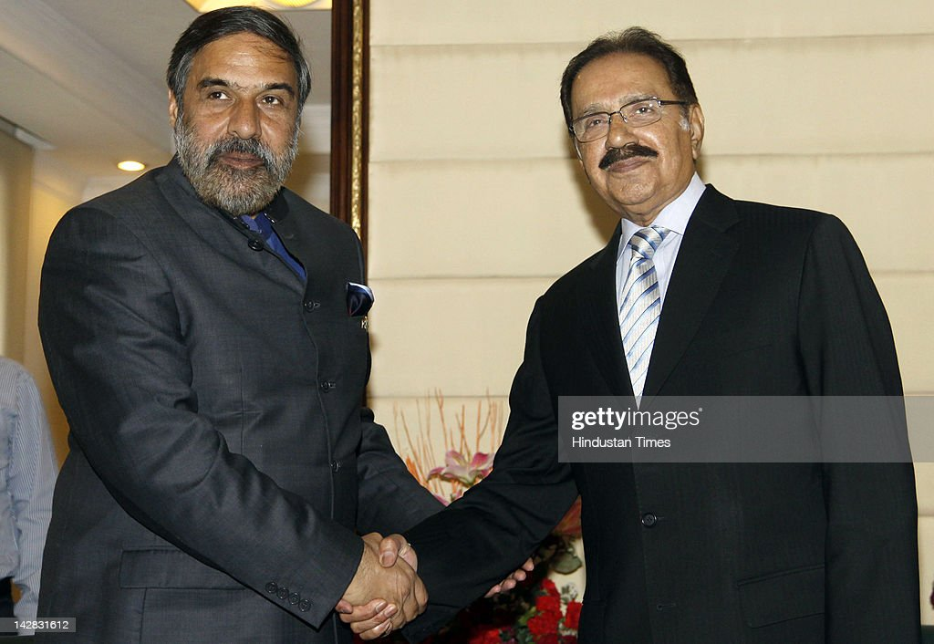 Pakistan's Commerce Minister Makhdoom Muhammad Amin Fahim (R) shakes hands with Indian Minister of Trade and Commerce Anand Sharma (L) during a joint press conference at Udhyog Bhavan on April 13, 2012 in New Delhi, India. India will allow Foreign Direct Investment (FDI) paving the way for industries from the neighboring countries to set up businesses in the growing Indian market.