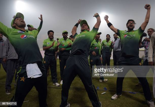 Pakistan's cricket team players celebrate after winning the third and final T20 cricket match against Sri Lanka at the Gaddafi Cricket Stadium in...