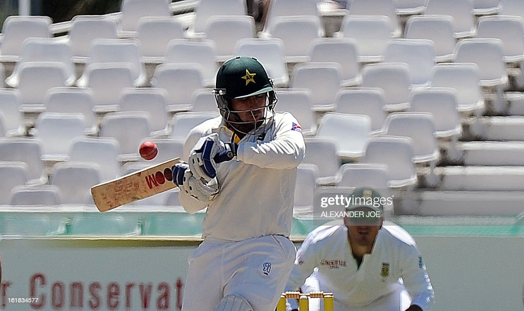 Pakistan's cricketer Saeed Ajmal plays a ball from unseen South African cricketer Dale Steyn on Day 4 of the Second Test between South Africa and Pakistan at Newlands in Cape Town, on February 17, 2013. AFP PHOTO / ALEXANDER JOE