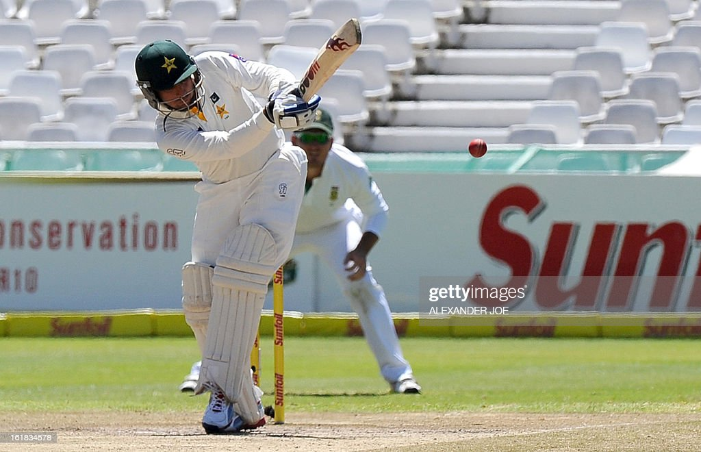 Pakistan's cricketer Saeed Ajmal plays a ball from unseen South African cricketer Dale Steyn on Day 4 of the Second Test between South Africa and Pakistan at Newlands in Cape Town, on February 17, 2013.