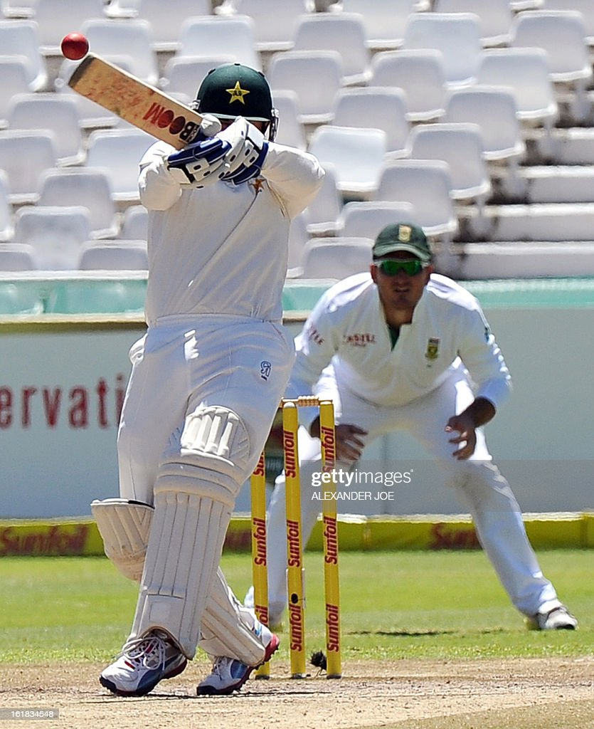Pakistan's cricketer Saeed Ajmal plays a ball from unseen South African cricketer Vernon Philander on Day 4 of the Second Test between South Africa and Pakistan at Newlands in Cape Town, on February 17, 2013. AFP PHOTO / ALEXANDER JOE