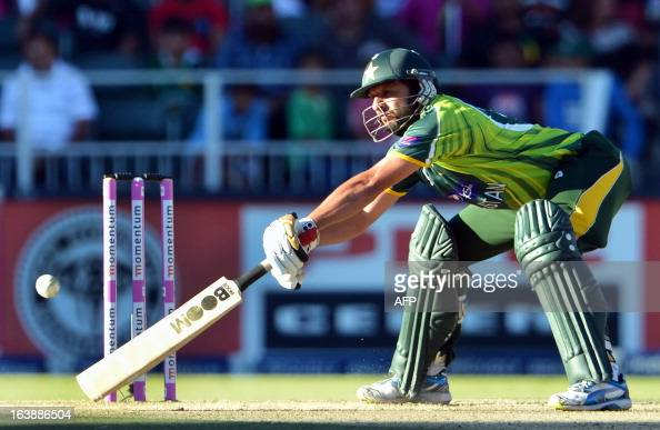 Pakistan's cricketer Shahid Afridi reaches for the ball with his bat during the 3rd OneDay International cricket match between South Africa and...