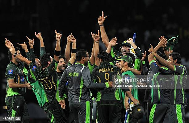 Pakistan's cricketers celebrate after their victory during the second Twenty 20 International cricket match between Sri Lanka and Pakistan at the R...