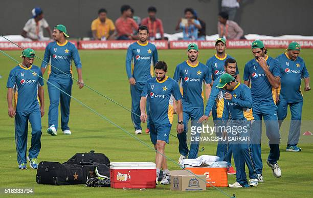 Pakistan's cricketers gather with their captain Shahid Afrididuring a training session at The Eden Gardens Cricket Stadium in Kolkata on March 18...