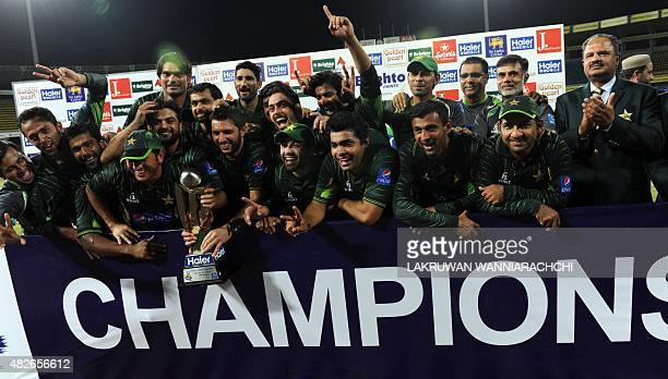 Pakistan's cricketers pose for photographers after their victory during the second Twenty 20 International cricket match between Sri Lanka and...