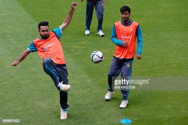 Pakistan's Fahim Ashraf and Pakistan's Shadab Khan play football during a nets practice session at The Oval in London on June 17 on the eve of the...