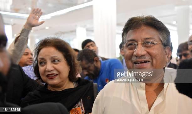 Pakistan's former military ruler Pervez Musharraf arrives with his wife Sehba Musharraf at the Dubai Iinternational airport before his departure to...