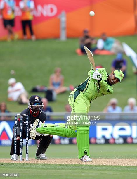 Pakistan's Haris Sohail plays a shot as United Arab Emirates wicketkeeper Swapnil Patil looks on during the Pool B Cricket World Cup match between...