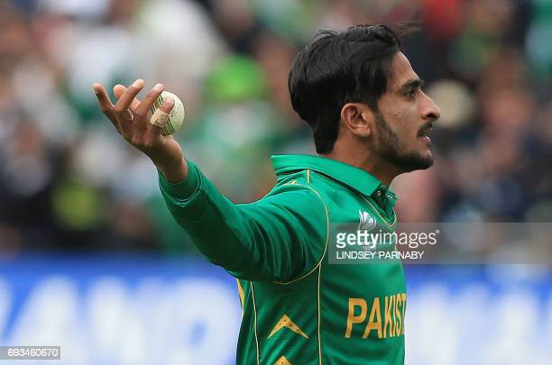 Pakistan's Hasan Ali celebrates taking the catch to dismiss South Africa's Kagiso Rabada off the bowling of Pakistan's Junaid Khan during the ICC...