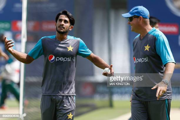 Pakistan's Hasan Ali talks with Pakistan's coach Mickey Arthur during a nets practice session at The Oval in London on June 17 on the eve of the ICC...