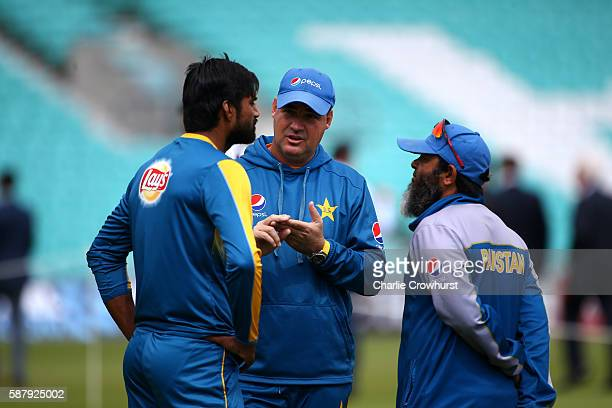 Pakistan's head coach Mickey Arthur chats with coach Mushtaq Ahmed and Rahat Ali during the England and Pakistan nets session at The Kia Oval on...