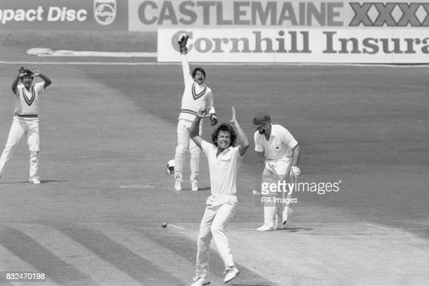Pakistan's Imran Khan celebrates trapping England's Bill Athey lbw for 26 as wicketkeeper Saleem Yousuf joins in the appeal