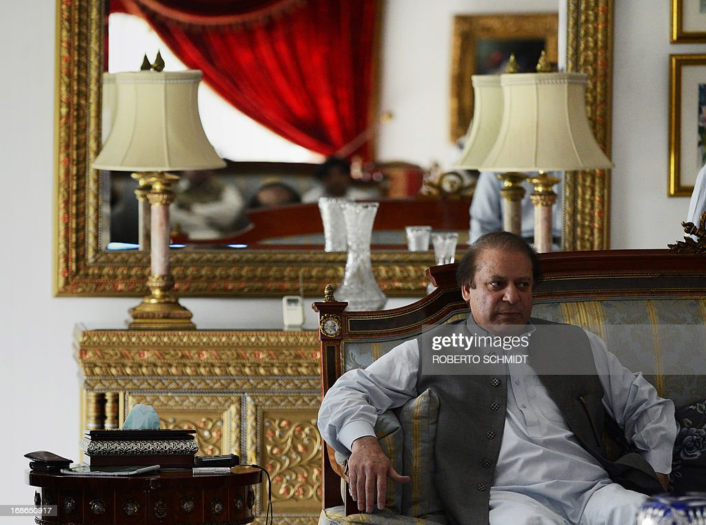 Pakistan's incoming prime minister Nawaz Sharif sits in a sofa in his farm home in Raiwind on the outskirts of Lahore on May 13, 2013. Sharif said that he would be 'very happy' to invite India's Manmohan Singh to his swearing-in ceremony. Nuclear-armed India and Pakistan have fought three wars, two of them over the disputed Himalayan region of Kashmir. AFP PHOTOS/ Roberto SCHMIDT