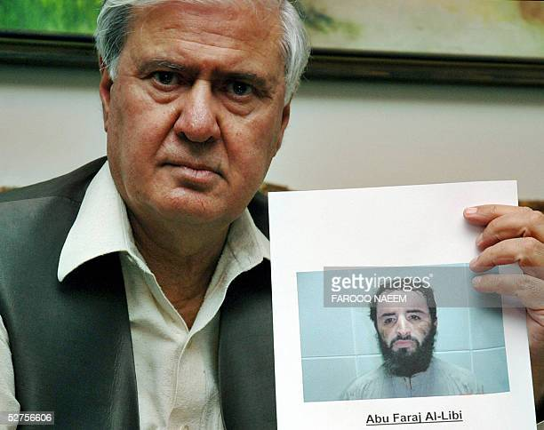 Pakistans Interior Minister Aftab Ahmed Khan Sherpao displays a picture of wanted terror suspect AlQaeda's Libyan planner Abu Faraj Farj during a...