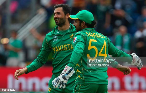Pakistan's Junaid Khan celebrates with Pakistan's Sarfraz Ahmed after taking the wicket of Sri Lanka's Thisara Perera for 1 run during the ICC...
