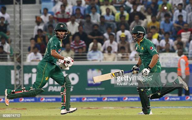 Pakistan's Khalid Latif and Babar Azam run between the wickets during the first T20I match between Pakistan and the West Indies at the Dubai...