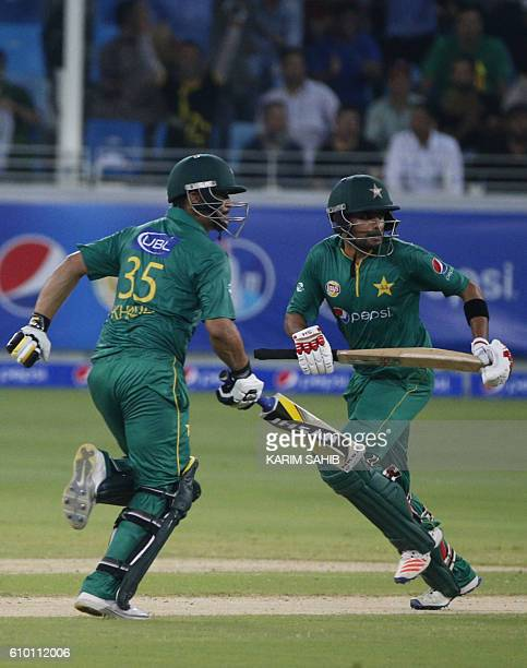Pakistan's Khalid Latif and Babar Azam run between the wickets during the second T20I match between Pakistan and the West Indies at the Dubai...