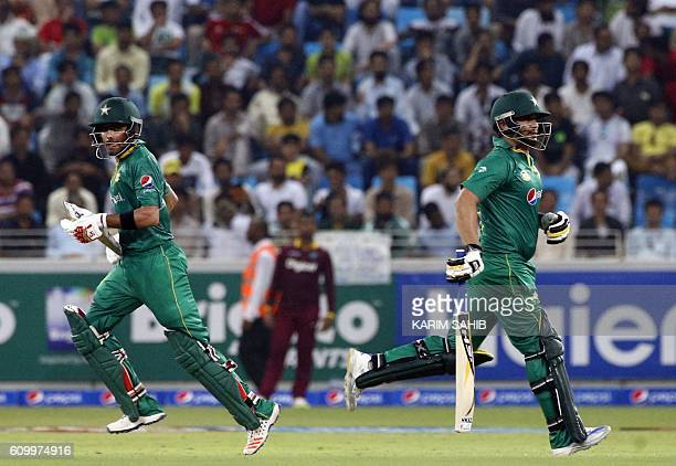 Pakistan's Khalid Latif and Sharjeel Khan run between the wickets during the first T20I match between Pakistan and the West Indies at the Dubai...