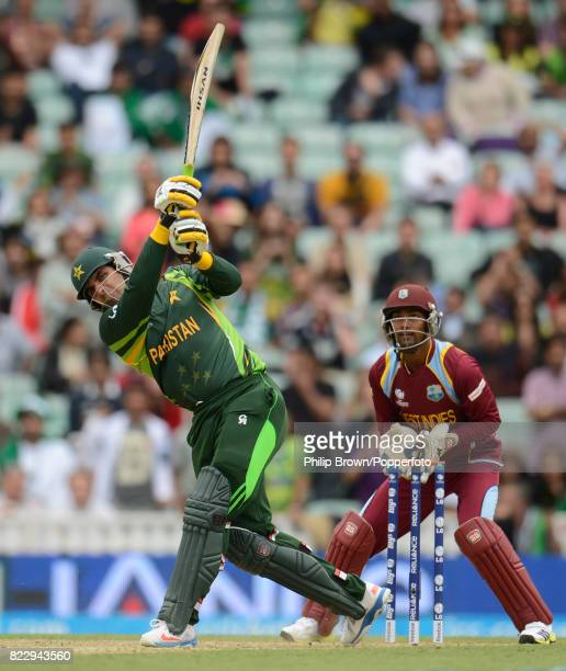 Pakistan's MisbahulHaq hits out during his innings of 96 not out watched by West Indies' wicketkeeper Denesh Ramdin in the ICC Champions Trophy group...