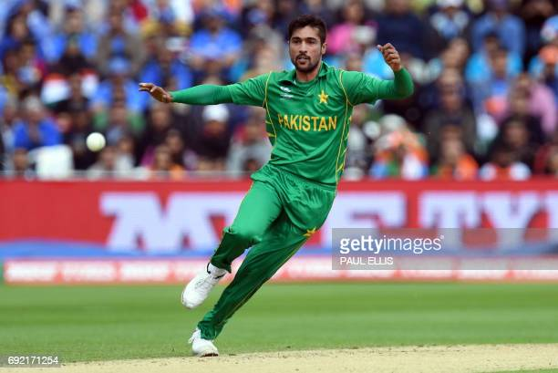 Pakistan's Mohammad Amir bowls during the ICC Champions trophy match between India and Pakistan at Edgbaston in Birmingham on June 4 2017 / AFP PHOTO...