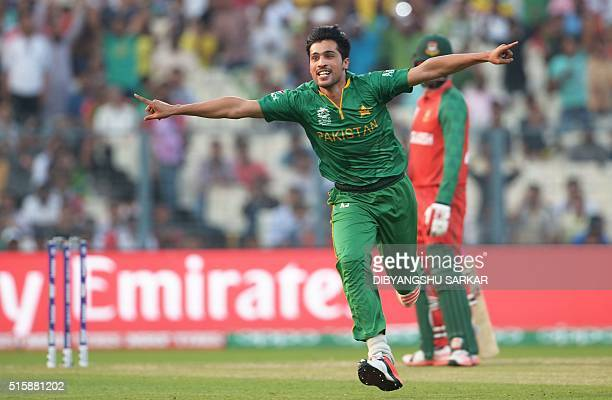 Pakistan's Mohammad Amir celebrates after the dismissal of Bangladesh's Soumya Sarkar during the World T20 cricket tournament match between Pakistan...