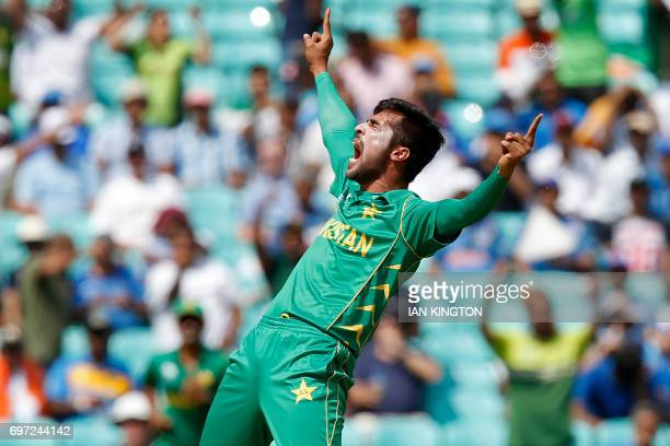 TOPSHOT Pakistan's Mohammad Amir celebrates taking the wicket of India's Rohit Sharma lbw for 0 during the ICC Champions Trophy final cricket match...