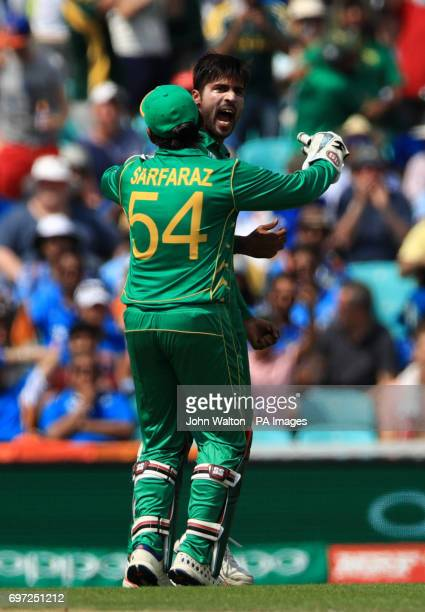 Pakistan's Mohammad Amir celebrates the wicket of India's Virat Kohli with teammate Sarfaraz Ahmed during the ICC Champions Trophy final at The Oval...
