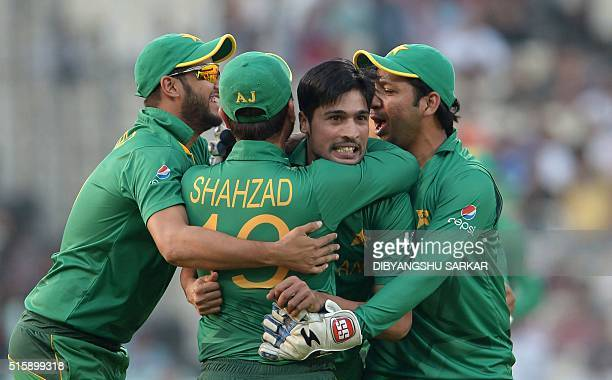 Pakistan's Mohammad Amircelebrates with teammates after the dismissal of Bangladesh's Soumya Sarkar during the World T20 cricket tournament match...