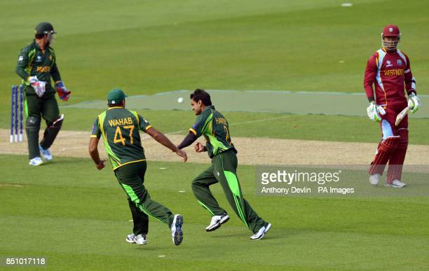 Pakistan's Mohammad Hafeez celebrates after Kamran Akmal stumped West Indies' Marlon Samuels during the ICC Champions Trophy match at The Oval London