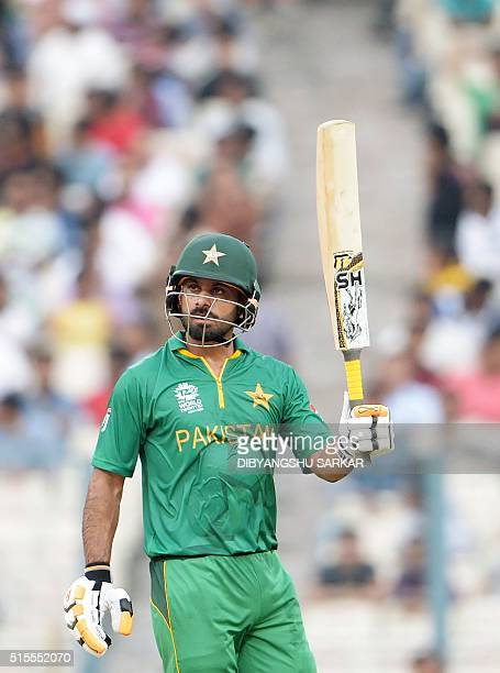 Pakistan's Mohammad Hafeez celebrates after scoring a halfcentury during a practice match between Pakistan and Sri Lanka at the Eden Gardens stadium...